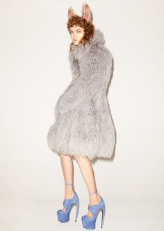 Little animal ears with fur to match. The shoes are what make it.