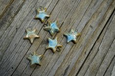 These terracotta star charms were glazed with a glaze that breaks into different shades of light blue. Price is for one approximately 15 mm charm.