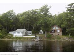 Amazing waterfront compound with two beautiful camps. The original 1955 camp has been updated in a clean and modern camp style, new kitchen and bath, a bonus room with a Murphy bed, and stone hearth with a gas fireplace. The 2012 chalet style camp is made from Maine logs, has a well appointed kitchen with granite counters, a gas stove in the living room, cathedral ceilings and a lovely sleeping loft. Between the two camps is a cozy bunkhouse! Well landscaped with cobblestone pathways, a shed…