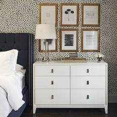 Thibaut Tanzania Wallpaper Black on Cream, navy tufted wingback bed. white bedding, West Elm Niche 6-Drawer Dresser