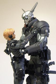 Deunan and Briareos from Appleseed Ex Machina Character Concept, Concept Art, Character Design, Statues, Masamune Shirow, Apple Seeds, Ex Machina, Sci Fi Characters, Ghost In The Shell