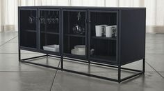 This would work in your dining room, but I don't know if you want the glass doors. Casement Black Large Sideboard | Crate and Barrel