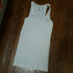NWOT Nike tank NWOT White ribbed Nike tank top. Has the Nike logo in grey on the left chest. Size large. No trades! Nike Tops Tank Tops