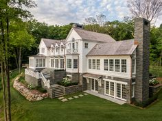 Custom builders John Kraemer & Sons built this lakeside coastal-inspired home that oozes luxury, comfort, and elegance. Colonial Exterior, Modern Farmhouse Exterior, Farmhouse Design, Exterior Design, Cottage Floor Plans, House Floor Plans, New England Style Homes, Different Types Of Houses, Dream House Exterior
