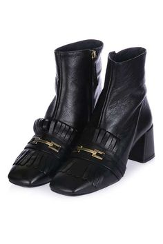 A cool twist on the black ankle boot, these easy-to-wear shoes feature fringe detail and a manageable mid heel. Wear with tailored trousers for a smart yet on-trend look. #Topshop