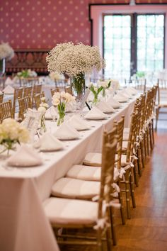 Large vase of baby's breath along with small vases of roses make for a great centerpiece idea. Photo: Modern Romance Flowers: JMFlora Design