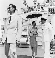 KING AND QUEEN OF THAILAND VISIT HMS LONDON. MARCH 1965, ON BOARD THE COUNTY CLASS GUIDED MISSILE DESTROYER HMS LONDON AT BANGKOK. DURING HMS LONDON'S VISIT THE KING AND QUEEN WERE WELCOMED ABOARD BY THE C IN C FAR EAST, ADMIRAL SIR VARYL BEGG.