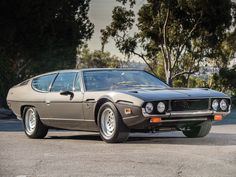 1973 Lamborghini Espada 400 GT Series III by Bertone | Arizona 2015 | RM AUCTIONS Interested in leasing a similar car? Visit pfsllc.com for more information on our leasing programs. #PremierFinancialServices #2015Scottsdale #rmauctions