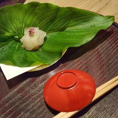 First course of an incredible kaiseki dinner at 2-Michelin star Seisoka in Tokyo.  Flatfish from Beppu Bay with shiso flowers served on an Asian skunk cabbage leaf (& no the leaf did not smell!). #kaiseki #washoku #michelin #seisoka #japanesefood #gourmet #gourmetdining #dinner #sashimi #delicious #amazing #tokyorestaurant by jeera_genie