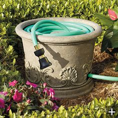 Hose Pot.  Cute idea, but dont think I would buy it.  Drill a few holes and put in a pipe/stone/or whatever as a guide.