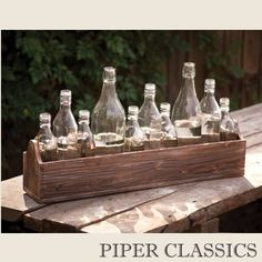 This boxed bottle centerpiece sleek lines and vintage reclaimed look adds a chic understated elegance. Visit Antique Farmhouse for more unique design items and centerpieces. Antique Farmhouse, Farmhouse Style, Farmhouse Decor, Farmhouse Ideas, Country Decor, Rustic Decor, Bottle Centerpieces, Unique Centerpieces, Centerpiece Ideas
