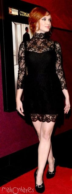 Christina Hendricks in Dolce and Gabbana and Dolce and Gabbana lace pumps at the 2010 season 4 premiere of 'Mad Men'