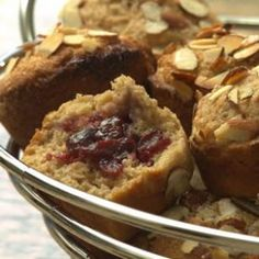Jam-Filled Almond Muffins: A crunchy topping of sugared toasted almonds and a surprise filling of almond-scented berry jam makes these whole-wheat muffins reminiscent of Danish pastries. They are perfect for a special breakfast or brunch.