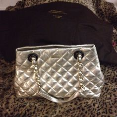 Kate Spade Maryanne quilted Tote Excellent condition.shopper style shoulder bag made of diamond quilting on lux leather. Dual shoulder straps with chain detail. Shoulder drop 8 1/4 length. Gold tone detailed hardware with front logo plaque. Flat bottom with feet to protect bag. Inside hidden magnetic closure. Custom champagne print interior lining. Multi functional slip pockets and zippered divider. kate spade Bags Totes