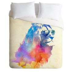 Reminds me of Bob Marley, Jamaica and Jesus/Chronicles of Narnia all at the same time. Might be cool for a teenage boy. Robert Farkas Sunny Leo Duvet Cover | DENY Designs Home Accessories