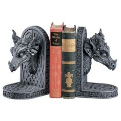 This pair of dragon bookends will try its best to keep books safe from unwelcomed borrowers! Cast in designer resin to capture the exquisite detail of the sculpt, spiraling horns and menacing faces sit atop a myriad of traditional Celtic crosses.