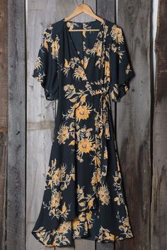 Lovely print wrap dress in black and gold / tan