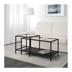 IKEA - VITTSJÖ, Nest of tables, set of 2, black-brown/glass, , The table tops in tempered glass are stain resistant and easy to clean.You can select the expression you like best, since the shelf is black on one side and black-brown on the other.Stands steady also on uneven floors since it has adjustable feet.Can be pushed together to save space.
