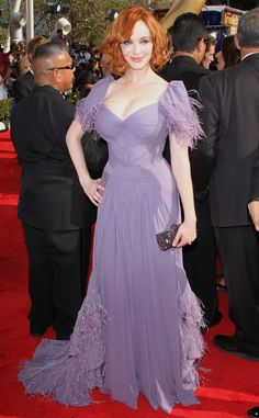 Christina Hendricks from Top 10 Iconic Looks From the Emmys Attention redheads: Uou have a color, and it is most definitely lavender. Specifically whatever shade of light purple this Zach Posen dress is. Ideal hue aside, the Mad Men star makes our list because the dress fit her flawlessly not to mention the fringe was the stuff of dreams.