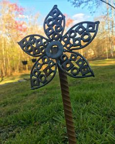 Scrap metal flower made from old recycled washers and rebar for the stem!