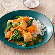 Kick up a #vegetarian meal with gingery butternut squash and tofu curry. | Health.com #recipe