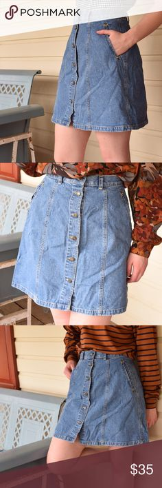 """Liz Claiborne button up jean skirt Liz Claiborne button down denim skirt vintage  features 2 front pockets and 6 different seams going down the front sides and back. meant to be worn at waistline size 10 petites  W-28"""" H-44"""" length-19"""" Let me know if you have any questions I'd love to help! Skirts Circle & Skater"""