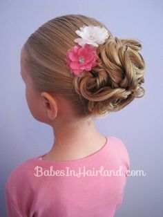 Easy Looped Updo from BabesInHairland.com - This was just as easy as the tutorial said it was, and my daughter's hair came out beautifully.  It has also stayed throughout her normal play during the day.
