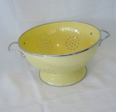 I want this! Somebody tell my husband ;) Vintage Shabby Chic Yellow Colander - 1950s - Farmhouse Kitchen - Yellow Chrome - Midcentury Home Decor. $16.00, via Etsy.