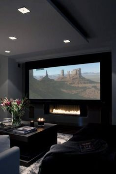 Modern Home Theater Design With Fireplace Under Projector Screen #hometheatreprojectors #hometheaterprojectorscreen
