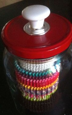 Close up shot of my cup cake liner storage jar! This large jar used to house olives! I painted the lid. The White handle was a left over door knob! Olive Jar, Cupcake Liners, Jar Storage, Glass Jars, Recycling, Door Knob, Make It Yourself, Olives, Pantry