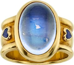 Moonstone, Sapphire, Gold Ring, Loree Rodkin  The ring features an oval-shaped moonstone cabochon measuring 16.00 x 11.50 mm, accented by heart-shaped sapphires, set in 18k gold.