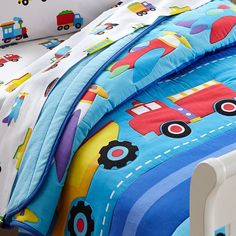 "Our comforter/quilt features a row of flying planes, a convoy of trucks and an adorable train pulling a caboose, all set against a background of blue stripes. Each vehicle is outlined quilted, making them ""pop"" off the quilt."
