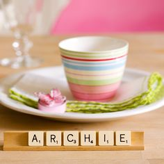 Use Scrabble letter tiles and trays to spell out your guests' names for a really personal and quirky place setting.