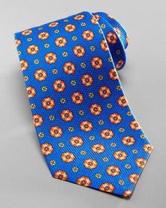 Grenadine tie with floral medallions. Silk. Made in Italy.
