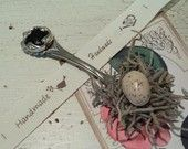I made these bird nest magnets from a collection of state spoons I bought at a flea market.