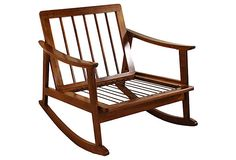Falling hard for the natural wood and clean lines of this 1950s rocking chair.