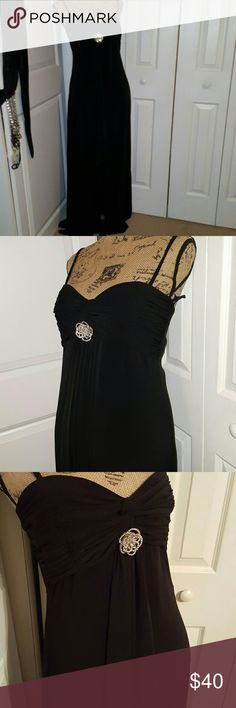 Gorgeous Black Evening Dress NWOT Black Evening Dress w/Zippered Back, Removable Straps, Embellished Flower Broach, Split and Lining.....55 inches from bust to bottom, 38 inch bustline, 36 inch waistline, 20 inch split, Stretchy material Dresses Strapless