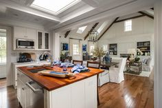 """The open kitchen leads straight to the dining room, making the entire home feel bright and airy. According to Linda, the kitchen """"is part of the party. You're not isolated, and I think that's how people want to live."""""""