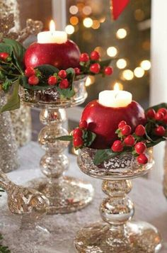 Create the centerpiece of your Christmas dreams with nothing more than an apple from the kitchen. Carve out the insides and stick a votive candle in it!