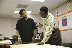 From Bail Bondsman to Teacher: Carey helps a student in his GED class at the Youth Empowerment Project.