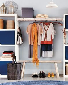 Don't have the space that a walk-in closet demands? Try building a walk-by. An old ladder bridges the gap between two basic shelving unit and creates a homey space to hang clothes -- a far cry from the typical sterile stainless-steel rod. When it comes to the shelves, display your neatest, prettiest things out in the open, but keep your dirty laundry to yourself: We added easy-to-make wool felt panels to hide slightly unsightly piles, and stashed T-shirts, socks, and scarves in woven…