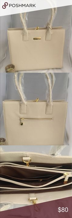 """Joy & Iman Genuine Leather Glamour Handbag NEW Joy& Iman bag. Color: White Linen Large handbag Genuine pebbled leather; Double rolled handles, Gold signature metal logo, Open top; flat bottom metal feet; accordian sides, Lobster claw, Lining trim Satin, Interior: 4 compartments, 1 center zipper compartment, 6 patch pockets, 8 card slots, 2 zipper pockets and 2 pen slots, Exterior: 1 zip pocket, some bags """"might"""" include one or all of the following Removable two-side mirror; removable pocket…"""