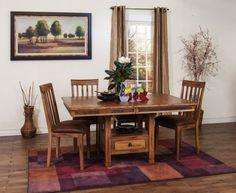 Express yourself with this rustic, all-wood dining set. The teal and earth-tone slate insets add drama to this five-piece Sedona Dining set. Available at Just Cabinets Furniture & More and online at JustCabinets.com
