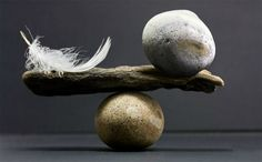 Victory - a hundredweight balanced against a plume  Defeat - a plume balanced against a hundredweigh