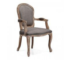 La silla Dortmund Armchair de un estilo shabby chic queda perfecta con una mesa rustica de madera.