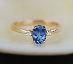 Blue sapphire engagement ring. Promise ring. Oval engagement