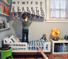 Love the calendar and light-up globe in this cool kids room.