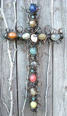 Google Image Result for http://images.monstermarketplace.com/wire-crosses-and-crucifixes/10-inch-rustic-semi-precious-gemstone-cross-600x1040.jpg