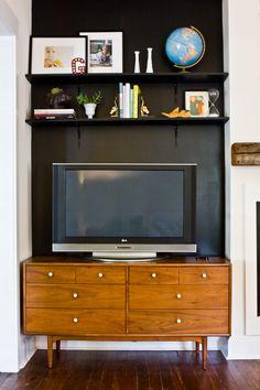black wall behind tv and inexpensive shelves :: Brick+Mortar Lesley Graham House Tour