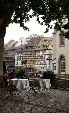 Streetside cafe tables in Strasbourg, France (by Kelley & Tim)